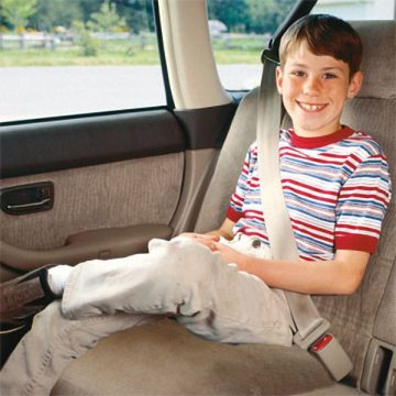 Kid in backseat with seat belt on